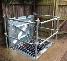 Defender Stamplock with pull through grids - Hinged Access Covers