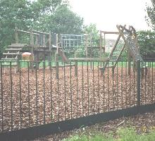 Flat Top Fencing with bark retainer - Playground Fencing