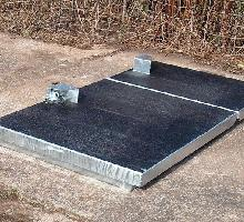 Upstand access cover with anti-slip coat