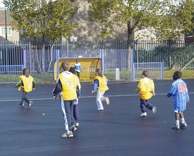 Children playing in School in new Junior MUGA