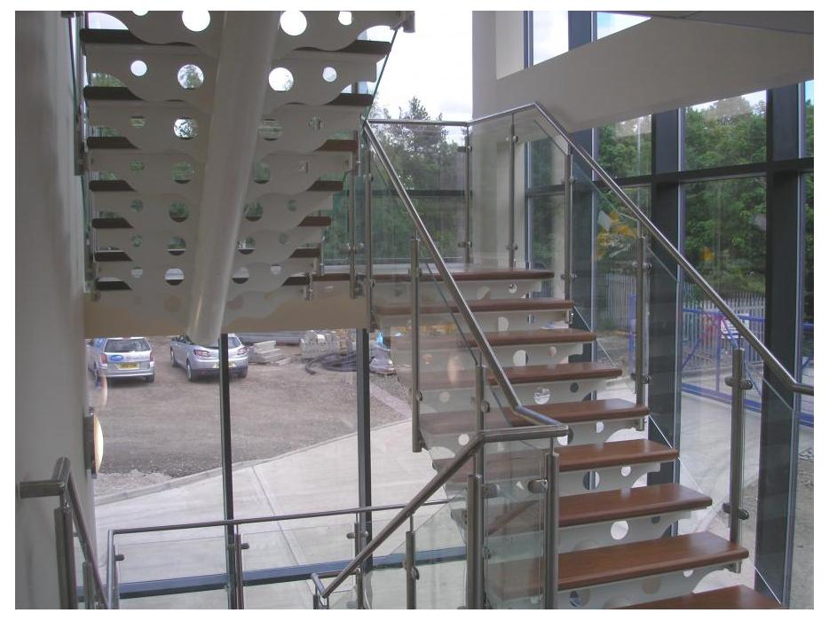 Architectural Steel staircase with glass balustrade
